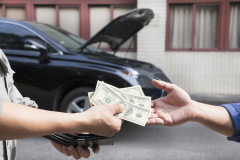 giving and taking money for car service concept